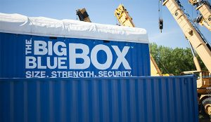 A big blue box sitting on a job site